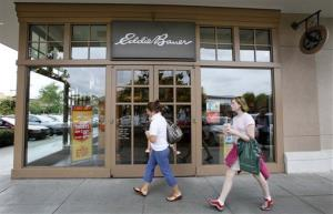 In this June 17, 2009 file photo, shoppers walk past an Eddie Bauer store in Seattle.