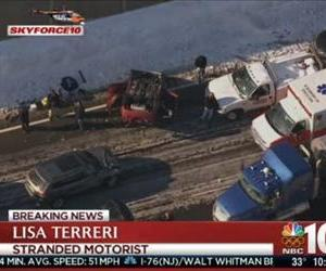 An overturned car is seen in this screenshot from NBC 10's live feed.