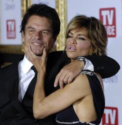 Lisa Rinna jokes with her husband Harry Hamlin at the 5th Annual TV Guide Emmy Party in Los Angeles, Sunday, Sept. 16, 2007.