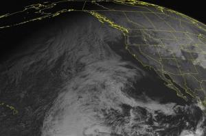 This NOAA satellite image taken Tuesday, December 24, 2013 shows a jet stream disturbance over the Tropics was spreading clouds northwards through the eastern Pacific.