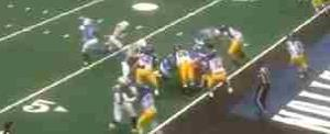 A screen shot from the game. Jennifer Welter has just taken the handoff from the quarterback.