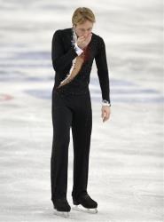 Evgeni Plushenko of Russia leaves the ice after pulling out of the men's short program figure skating competition during the 2014 Winter Olympics, Feb. 13, 2014, in Sochi, Russia.