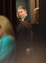Michael Dunn leaves the courtroom after the verdict is read in Jacksonville, Fla. Saturday, Feb. 15, 2014.