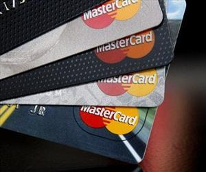 In this Thursday, April 25, 2013, file  photo, MasterCard credit cards are displayed.