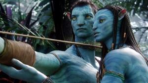 This film publicity image released by 20th Century Fox shows the characters Neytiri, voiced by Zoe Saldana, right, and Jake, voiced by Sam Worthington, in a scene from 'Avatar.'