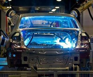 In this July 31, 2012, file photo, robotic arms weld the interior of a Volkswagen Passat sedan at the German automaker's plant in Chattanooga, Tenn.