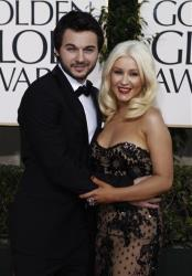 In this Jan. 16, 2011 file photo, Christina Aguilera, right, arrives with Matthew Rutler for the Golden Globe Awards  in Beverly Hills, Calif.
