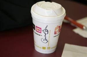 A coffee cut signed for a customer by Democratic presidential hopeful Sen. Barack Obama D-Ill., sits on a table at Dunkin' Donuts, Tuesday, Jan. 8, 2008 in Manchester, NH.