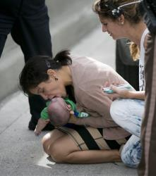 Pamela Rauseo, 37, performs CPR on her nephew.