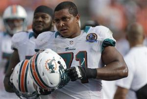 In this Dec. 16, 2012 file photo, Miami Dolphins tackle Jonathan Martin (71) watches from the sidelines during the second half of an NFL football game against the Jacksonville Jaguars, in Miami.