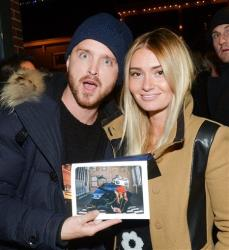 Aaron Paul poses with Lauren Parsekian at the Chase Sapphire Preferred Hellion premiere party during the Sundance Film Festival, on Friday, January 17, 2013 in Park City, Utah.
