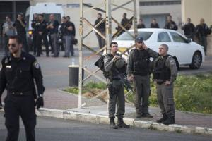 Israeli border police officers stand at the entrance to Sharon prison, near Raanana, Israel, Sunday, Feb. 23, 2014. Police say a SWAT team killed an inmate who seized a weapon and shot three guards.