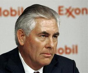 In this Wednesday, May. 27, 2009 photo, Exxon Mobil Chairman and CEO Rex W. Tillerson speaks at a news conference following the annual shareholders meeting in Dallas.