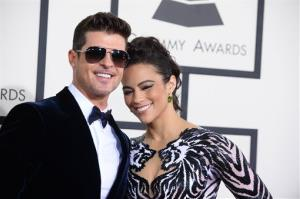 Robin Thicke, left, and Paula Patton arrive at the 56th annual Grammy Awards at Staples Center on Sunday, Jan. 26, 2014, in Los Angeles.