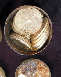 One of the decaying metal canisters filled with 1800s-era U.S. gold coins that was unearthed in California.