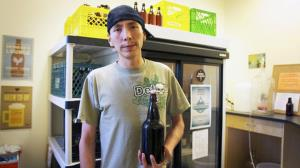 A member of the program is seen with a bottle of home-brewed beer.