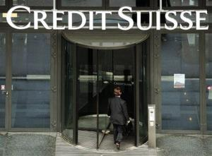 In this May 12, 2010 file picture, a man enters a Credit Suisse bank in Zurich, Switzerland.