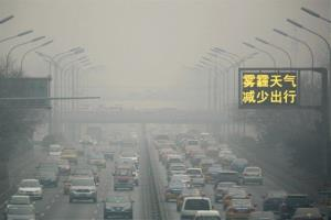 Vehicles clog a main highway during a sixth straight day of severe pollution in Beijing Tuesday.