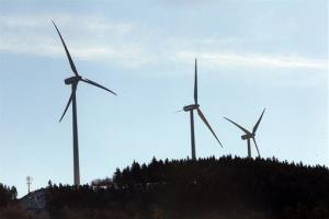 In this photo taken Tuesday Jan. 28, 2014 wind turbines are seen in Rumney, NH.