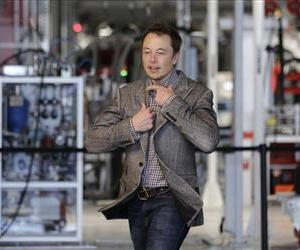 Tesla CEO Elon Musk prepares himself as he walk through the assembly area at the Tesla factory in Fremont, Calif., June 22, 2012.