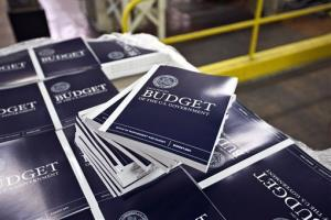 Copies of President  Obama's budget plan for fiscal year 2014 are prepared for delivery at the US Government Printing Office in Washington.