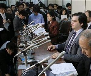 Mt. Gox CEO Mark Karpeles, sitting at second right,  attends a press conference at the Justice Ministry in Tokyo Friday night, Feb. 28, 2014.