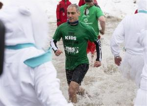 Chicago Mayor Rahm Emanuel exits the water during the Chicago Polar Plunge, Sunday, March 2, 2014, in Chicago. Emanuel joined Jimmy Fallon in the event.