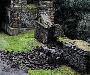 Bricks and rocks are seen on the ground after, according to Italian media, they collapsed from the Porta Nocera doorway in Pompeii, as a consequence of a rainstorm, Sunday, March 2, 2014.