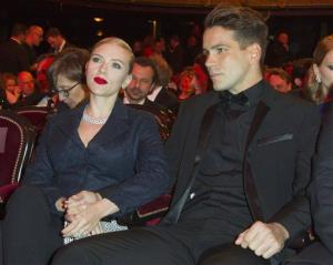 Scarlett Johansson and Romain Dauriac sit prior to the start of the 39th Cesar Film Awards at Theatre du Chatelet in Paris, France, Friday, Feb. 28, 2014.
