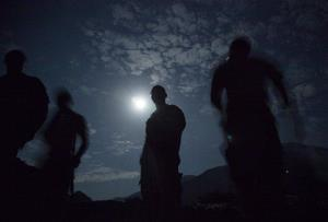 Members of the US Army's Bravo Company of the 25th Infantry Division are silhouetted by the moonlight on Sept. 10, 2011 at Combat Outpost Monti in Kunar province, Afghanistan.