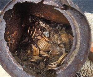 Oone of the six decaying metal canisters filled with 1800s-era gold coins unearthed in California by two people who want to remain anonymous.