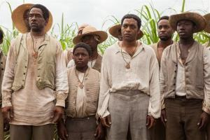 This image released by Fox Searchlight shows Chiwetel Ejiofor, second right, in a scene from 12 Years A Slave.