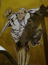 Graffiti depicting Pope Francis as Superman and holding a bag with writing that reads Values is seen on a wall of the Borgo Pio district near St. Peter's Square in Rome, Tuesday, Jan. 28, 2014.