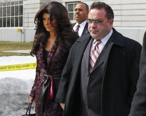 "Teresa, left, and Joe Giudice, from ""The Real Housewives of New Jersey,"" leave federal court in Newark, NJ on Tuesday, March 4, 2014."