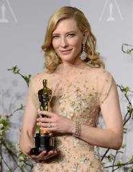 Cate Blanchett poses in the press room with the award for best actress in a leading role for Blue Jasmine during the Oscars Sunday, March 2, 2014, in Los Angeles.