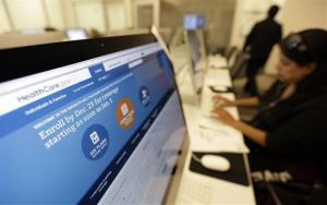 In this Dec. 11, 2013, file photo, people access the Affordable Care Act website in San Antonio.