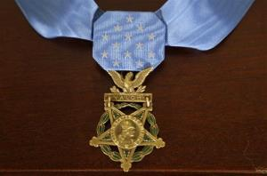 The Medal of Honor sits on a table, Monday, Aug. 26, 2013, in the East Room of the White House in Washington.