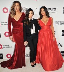 Khloe Kardashian, from left, Kourtney Kardashian, and Kim Kardashian arrive at 2014 Elton John Oscar Viewing and After Party Mar. 2, 2014 in West Hollywood, Calif.