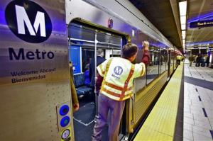 A Metro Gold Line train operator checks his gates before departing.