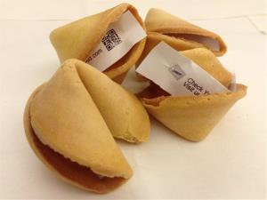 This Fortune Cookie Advertising photo shows the company's print advertisements inside fortune cookies.