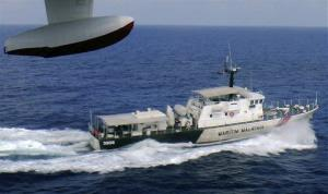 A patrol vessel of Malaysian Maritime Enforcement Agency searches for the missing Malaysia Airlines plane off Kelantan, Malaysia, Sunday, March 9, 2014.