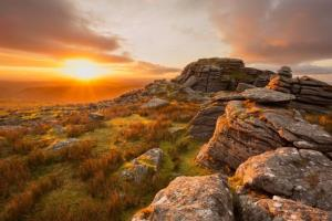 The photo shows Dartmoor, an area of moorland in South Devon, England, where the remains were found.