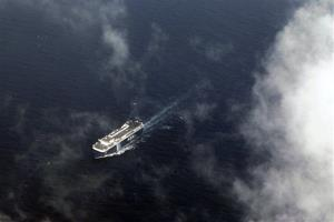 A vessel is seen from an Antonov AN-26 aircraft of the Vietnam Air Force during the search operation over the Gulf of Thailand between Malaysia and Vietnam today.