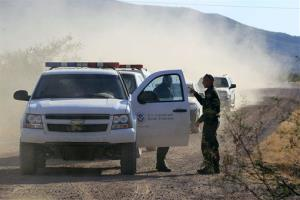 In this Oct. 2, 1012 file photo, U.S. Customs and Border Protection officers and other law enforcement jurisdictions drive the roads near near Bisbee, Ariz.