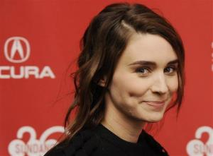 Actress Rooney Mara smiles as she arrives at the premiere of the film The One I Love at the 2014 Sundance Film Festival, Tuesday, Jan. 21, 2014, in Park City, Utah.