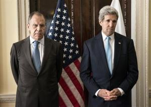 Russian Foreign Minister Sergei Lavrov, left, and US Secretary of State John Kerry stand together before a meeting in London Friday.