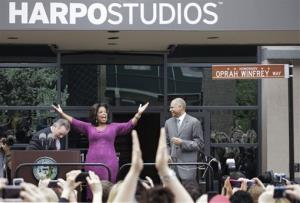 This May 11, 2011, file photo shows talk-show host Oprah Winfrey reacting after a street outside her Harpo Studios in Chicago was proclaimed Oprah Winfrey Way.