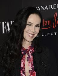 Fashion designer L'Wren Scott arrives at the Banana Republic L'Wren Scott Collection launch party at the Chateau Marmont on Tuesday, Nov. 19, 2013 in West Hollywood, Calif.