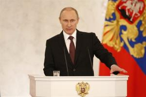 Russian President Vladimir Putin addresses the Federation Council in Moscow's Kremlin on Tuesday, March 18, 2014.