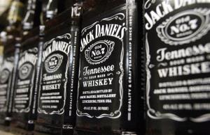 In this Dec. 5, 2011 file photo, bottles of Jack Daniel's Tennessee Whiskey, line the shelves of a liquor outlet, in Montpelier, Vt.